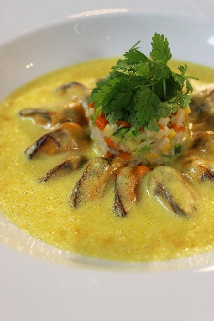 Gratin van mosselen met groentjes en curry